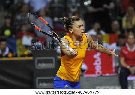 CLUJ-NAPOCA, ROMANIA - APRIL 16, 2016: WTA 6 ranked woman tennis player Simona Halep plays against Andrea Petkovic during a Fed Cup Play-Offs Tennis match, Romania vs Germany - stock photo
