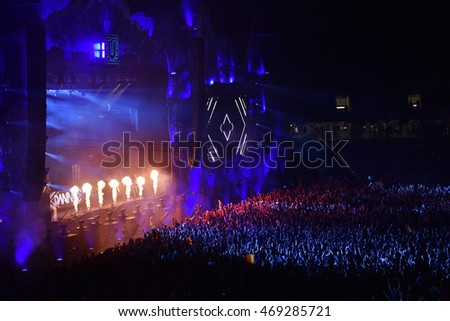 CLUJ NAPOCA, ROMANIA - AUGUST 5, 2016: Crowd of people, audience partying in the front of the stage at a Dannic live mixing concert at Untold festival