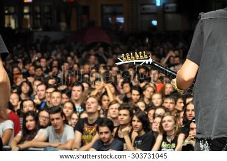 CLUJ NAPOCA, ROMANIA - AUGUST 2, 2015: Headbanging crowd during a rock concert at the Untold Festival
