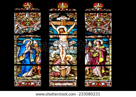 CLUJ NAPOCA, ROMANIA - AUGUST 21, 2014: Jesus Christ Crucifixion Stained Glass Window Inside The Gothic Roman Catholic Church of Saint Michael Built In 1390. - stock photo