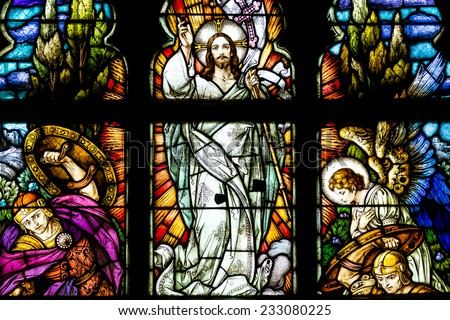 CLUJ NAPOCA, ROMANIA - AUGUST 21, 2014: Jesus Christ Resurrection Stained Glass Window Inside The Gothic Roman Catholic Church of Saint Michael Built In 1390. - stock photo