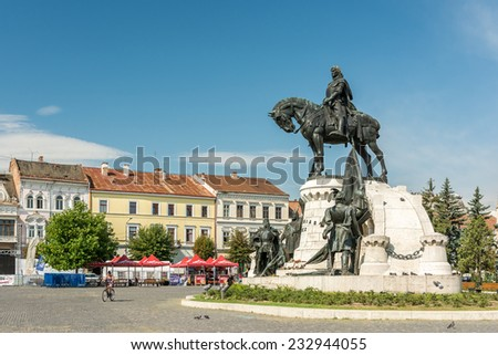 CLUJ NAPOCA, ROMANIA - AUGUST 21, 2014: The Matthias Corvinus Monument is a historic monument in Cluj-Napoca conceived by Janos Fadrusz and opened in 1902.