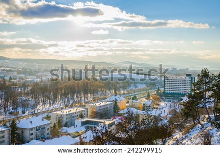 CLUJ-NAPOCA, ROMANIA - 06 JANUARY 2015: View of Cluj Arena, Cluj Napoca Central Park and Napoca Hotel on a sunny winter day with beautiful white snow and sun rays