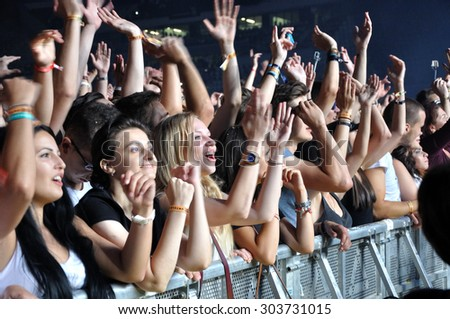 CLUJ NAPOCA, ROMANIA - JULY 30, 2015: Crowd of cheerful young people having fun  during a live concert at Untold Festival in the European Youth Capital city of Cluj Napoca - stock photo