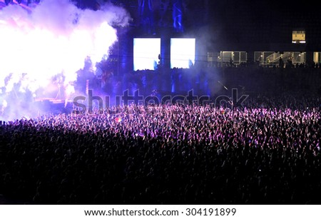 CLUJ NAPOCA, ROMANIA - JULY 30, 2015: Crowd of party people raising their hands during an ATB live concert at the Untold Festival   - stock photo
