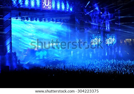 CLUJ NAPOCA, ROMANIA - JULY 30, 2015: Crowd of party people raising their hands during an ATB live concert at the Untold Festival