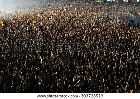 CLUJ NAPOCA, ROMANIA - JULY 31, 2015: Crowd of party people raising their hands during an Avicii live concert at the Untold Festival  - stock photo
