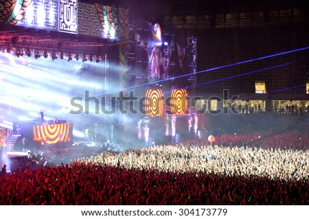 CLUJ NAPOCA, ROMANIA - JULY 30, 2015: Crowd of partying people enjoy a Dimitri Vegas and Like Mike live concert at the Untold Festival in the European Youth Capital city of Cluj Napoca