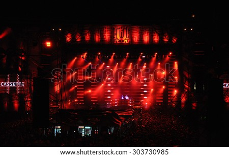 CLUJ NAPOCA, ROMANIA - JULY 31, 2015: Disc jokey Casette mixing on the stage during a live concert at Untold Festival in the European Youth Capital city of Cluj Napoca - stock photo