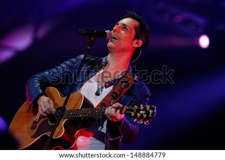 CLUJ NAPOCA, ROMANIA - JUNE 8: The famous rock&roll singer Stefan Banica Jr. performs on stage during the Cluj Arena Music Fest 2013, on June 8, 2013 in Cluj Napoca, Romania.