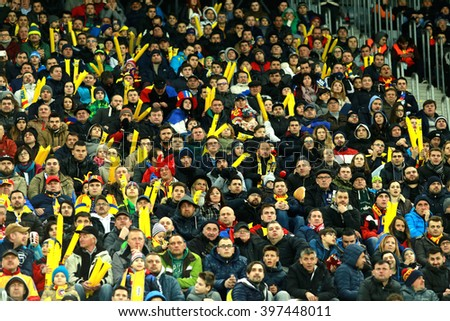 CLUJ-NAPOCA, ROMANIA - MARCH 27, 2016: Crowd of people supporting their team during a friendly football match between Romania against Spain, both of them qualified for Euro 2016 in France - stock photo