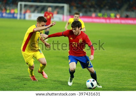 CLUJ-NAPOCA, ROMANIA - MARCH 27, 2016: David Silva (red) player of Manchester City and the Spain national team playing against Romania before Euro 2016 - stock photo
