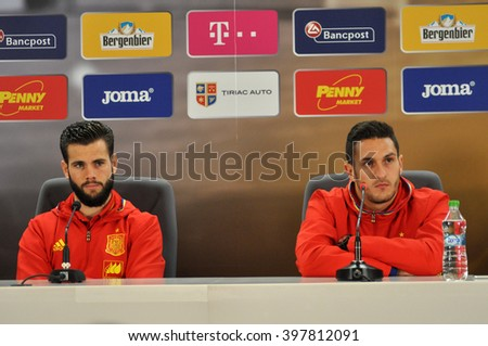 CLUJ-NAPOCA, ROMANIA - MARCH 26, 2016: Players Nacho Fernandez Iglesias and Jorge Resurrecion Merodio speaking during a press conference before the Romania-Spain match - stock photo