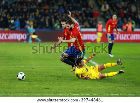 CLUJ-NAPOCA, ROMANIA - MARCH 27, 2016: Romanian National Team football player Nicolae Stanciu (yellow) in action during a friendly match against Spain before Euro 2016