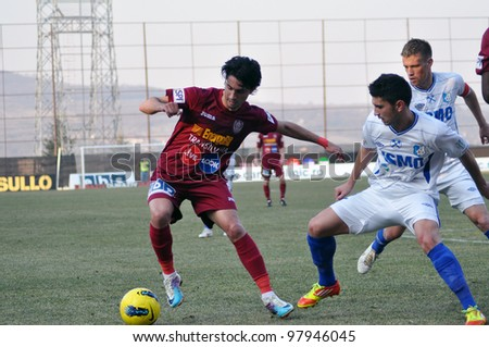 CLUJ-NAPOCA, ROMANIA �¢?? MARCH 17: Rui Pedro (in red) in action at a Romanian National Championship soccer game CFR Cluj vs. Pandurii Targu Jiu, March 17, 2012 in Cluj-Napoca, Romania