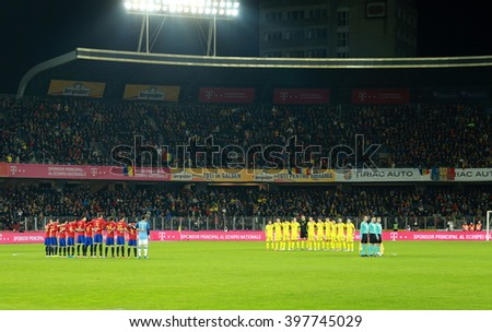 CLUJ-NAPOCA, ROMANIA - MARCH 27, 2016: The National Football Team of Spain and Romania, hold a moment of silence in the memory of legendary player Johan Cruyff before friendly match