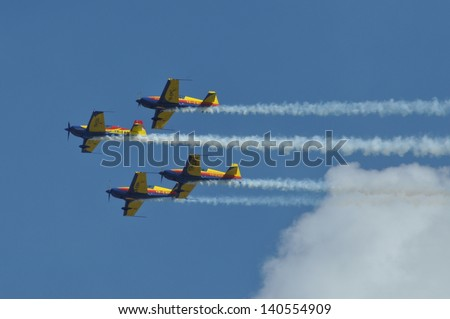 CLUJ NAPOCA, ROMANIA - MAY 18: Military aircraft fly in formation over at the city of Cluj at the Romanian Military Parade on May 18, 2013 in Cluj Napoca, Romania