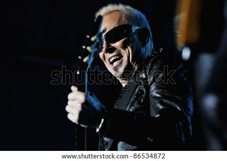 CLUJ NAPOCA, ROMANIA – OCTOBER 8: Guitarist Rudolf Schenker from Scorpions rock band performs live at Cluj Arena Grand Opening concert on October 8, 2011 in Cluj-Napoca, Romania - stock photo