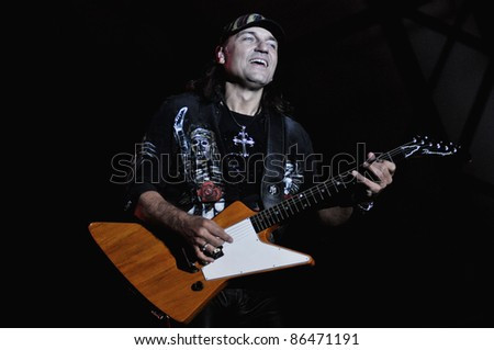 CLUJ NAPOCA, ROMANIA – OCTOBER 8: Matthias Jabs guitarist from Scorpions rock band performs live at Cluj Arena Grand Opening concert on October 8, 2011 in Cluj-Napoca, Romania - stock photo