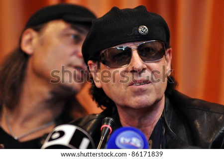 CLUJ NAPOCA, ROMANIA – OCTOBER 07: Matthias Jabs (L) and Klaus Meine (R) from Scorpions rock band attend Cluj Arena Opening press conference, at Hotel City Plaza on Oct. 07, 2011 in Cluj, Romania
