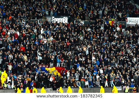 CLUJ, ROMANIA - MARCH 4: Soccer fans of Universitatea Cluj supporting their favorites during a derby against CFR Cluj. Final score: CFR Cluj - U Cluj: 1-2. On March 24, 2014 in Cluj-Napoca, Romania - stock photo