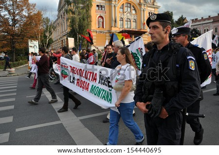 CLUJ - SEPT 15: People join a protest against the Romanian Government that passed a law allowing the gold extraction project at Rosia Montana against the people's will. Sept 15, 2013 in Cluj, Romania