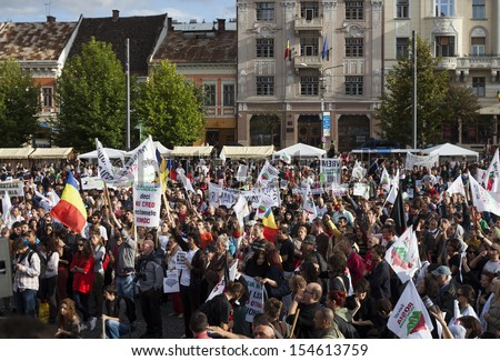 CLUJ - SEPT 15: People join a protest against the Romanian Government that passed a law allowing the gold extraction project at Rosia Montana. On Sept 15, 2013 in Cluj, Romania