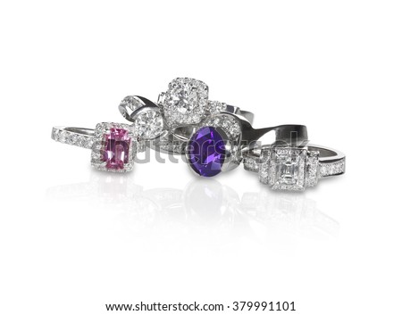 Cluster grouping stack of diamond wedding engagement rings with colored diamonds and gemstones - stock photo