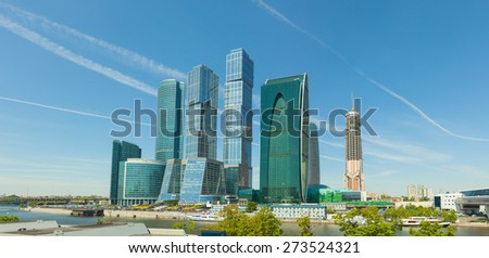Cluster of beautiful, modern, high-rise buildings in the heart of Moscow, Russia, towering over a bend in the Moskva River. - stock photo