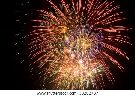 Cluster of colorful fireworks with copyspace