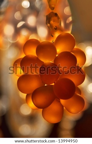 Cluster of crystal pendants on a chandelier, lit from inside - stock photo