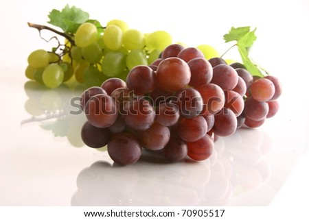 cluster of fresh grape on the white - stock photo