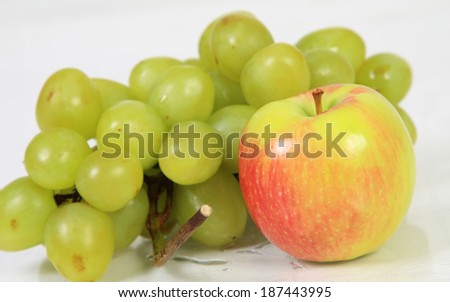 cluster of grapes and apple - stock photo