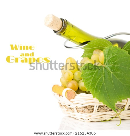 Cluster of grapes in wicker basket with wine bottle behind it. Winery background isolated on white - stock photo