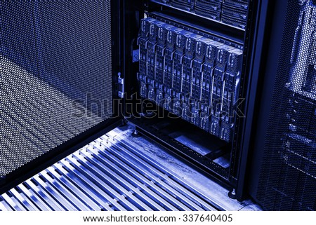 cluster of hard drives in a data center rack - stock photo