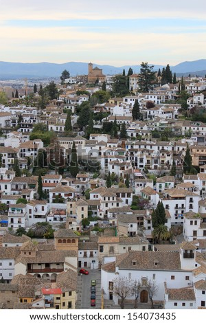 Cluster of houses and rooftops along the hillside in the Albaicin area of Granada, Spain