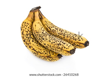 Cluster of over ripe bananas isolated on white background