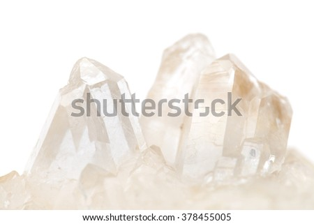 cluster of small quartz crystals isolated on white background - stock photo
