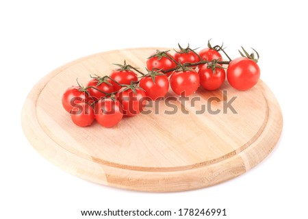 Cluster of Tomatoes on wooden platter. Isolated on a white background. - stock photo