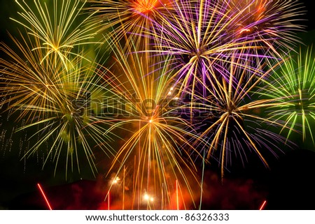 Cluster of vibrant fireworks - stock photo