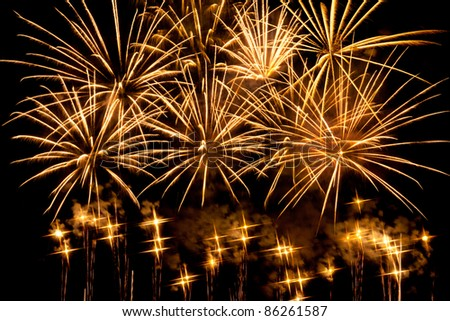 Cluster of vibrant fireworks. Stars filter used - stock photo