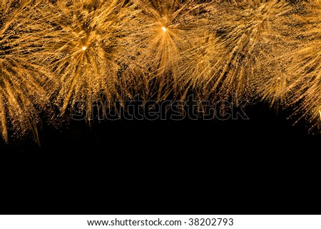 Cluster of yellow fireworks with copyspace