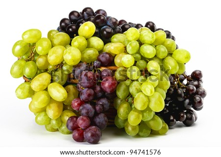 clusters of white and black grapes in a basket on a white background - stock photo