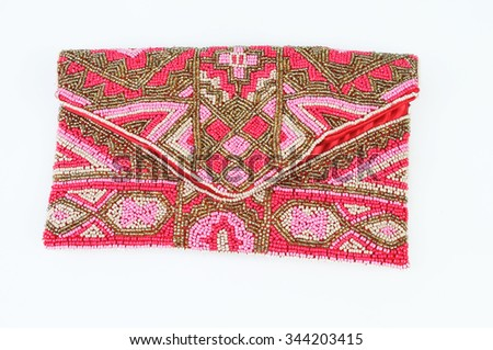 Clutch bag embroidered with beads isolated on white background - stock photo