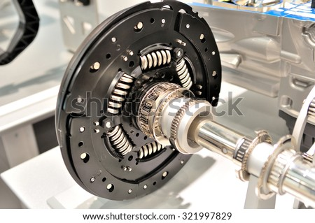 Clutch plate on an axle with bearing. - stock photo
