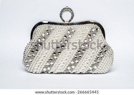 clutch with diamonds on a white background - stock photo
