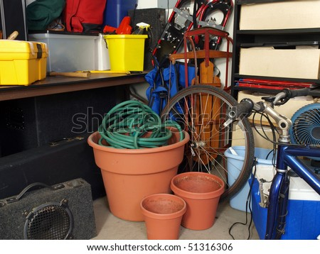 Cluttered corner of a busy suburban garage. - stock photo