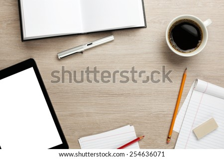 Cluttered office desk background - stock photo