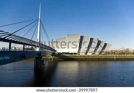 Clyde Auditorium, known as the armadillo, in Glasgow, Scotland, UK. Next to it is the Bell's Bridge crossing the River Clyde.