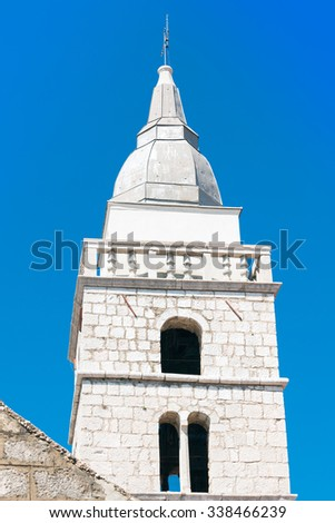 Cmisalj, bell tower of the church. Island of Krk, Croatia - stock photo